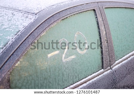 """Frozen car window with scratched text on the ice: """"-20"""" (minus twenty) #1276101487"""