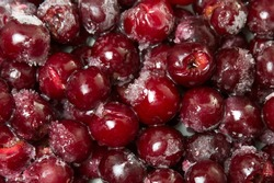 Frozen cherry fruit on a pile background