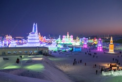 Frozen city showing its vivid color at night through snow and ice sculpture lighting in snow festival, Harbin, China