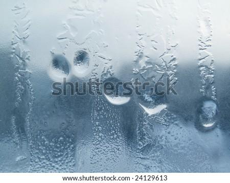 Frozen drops of water on a window pane