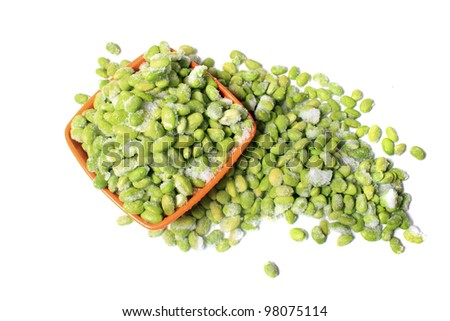 Frozen edamame also known as soybeans in a bowl on a white background
