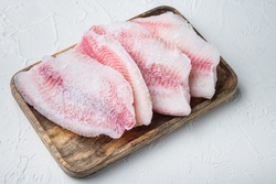 Frozen fish fillet, on white background