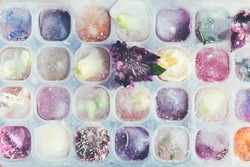 Frozen Flowers in Ice Cubes on Light Background, floral ice