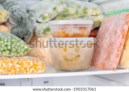 Frozen food in the freezer. Frozen vegetables, soup, ready meals in the freezer Stockfoto ©