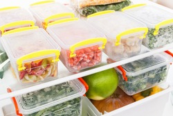 Frozen food in the refrigerator. Vegetables on the freezer shelves.