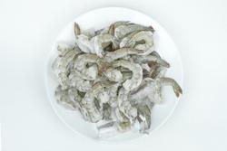 Frozen Fresh Shrimp on a white plate, on white background