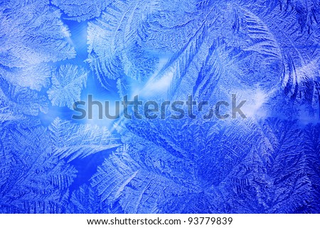 Frozen frost at a winter window glass