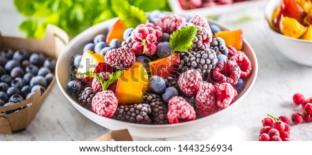 Frozen fruits blueberries blackberry raspberry red currant peach and herbs melissa. #1443256934