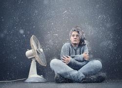 Frozen girl beside  a powerful fan , fan causing snow