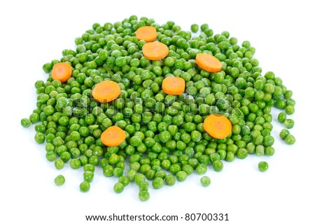 Frozen green peas with carrots on the table