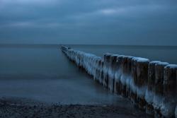 frozen groins at beach of Baltic sea in winterseason