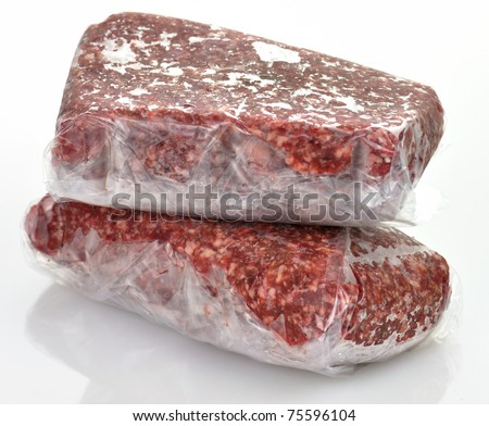 frozen ground meat in plastic package, close up