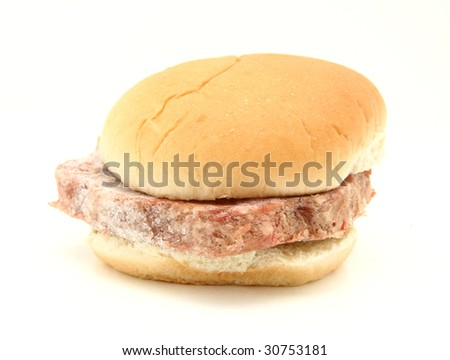 Frozen Hamburger Patty In Bun Isolated On White