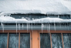 Frozen icicles hanging in front of windows