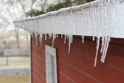 Frozen Icicles on Red Barn