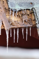 Frozen Icicles on Wood Barn