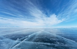 Frozen Lake Baikal. Beautiful stratus clouds over the ice surface on a frosty day. Natural background