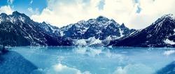 Frozen lake Morskie oko with mountain landscape in Poland - panorama