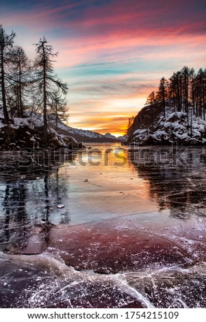 Frozen Lake Sils (Silsersee), Engadin, Grisons, Switzerland. Lake Sils is the largest natural lake in the Alps lying above 1,000 metres.