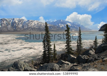 Frozen lake thawing in the Spring in the Wrangell Mountains in Alaska