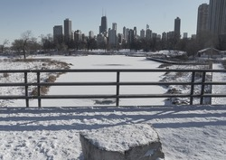 frozen Lincoln Park  lagoon looking south to Chicago city