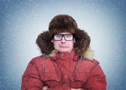 Frozen man in winter clothes and glasses, cold, snow, blizzard