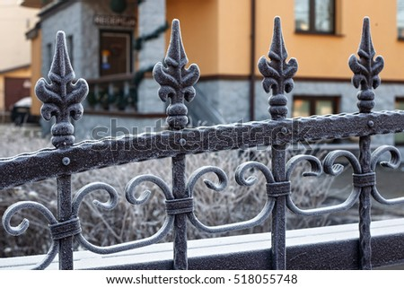 Frozen metal fence covered by hoarfrost in a winter. #518055748