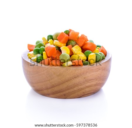 Frozen mixed vegetables isolated on white background.