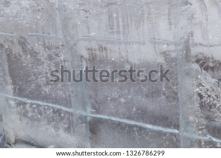 frozen natural translucent glowing glacier crystals, macrostructure of transparent ice close-up, iceberg ice