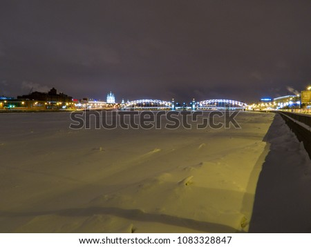 Frozen Neva River with the Bolsheokhtinsky Bridge and the Smolny Cathedral in the background. In St. Petersburg, Russia  #1083328847