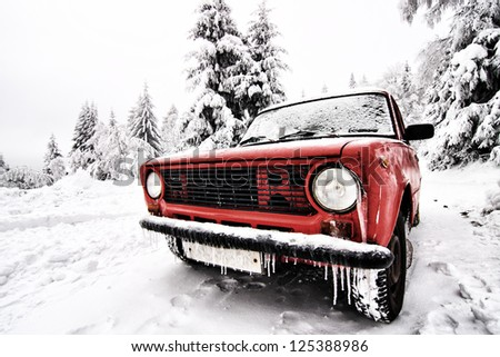 Frozen old Russian car in the winter