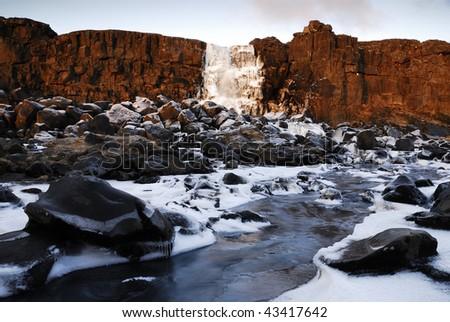 Frozen Oxararfoss waterfall, Pingvellir national park, Iceland