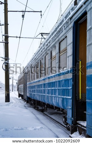 frozen passenger train with icicles and ice on its surface. Railway in the cold winter season #1022092609