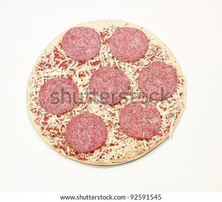 frozen pizza with salami and cheese isolated on white background