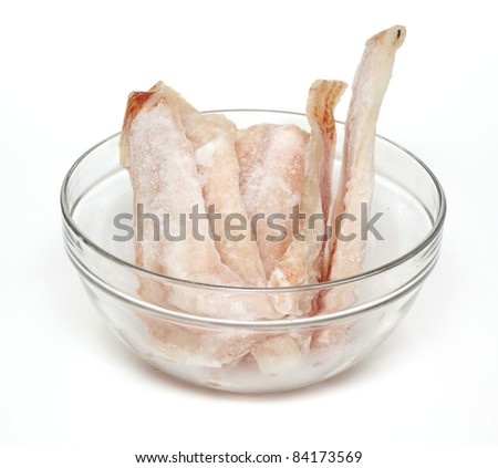 frozen pollock (pallock) in a glass bowl on white background