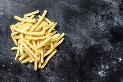 Frozen potatoes, French fries, canned food. Black background. Top view. Copy space