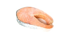 frozen raw steak of atlantic salmon isolated on white background. The concept of healthy eating. Healthy fast food