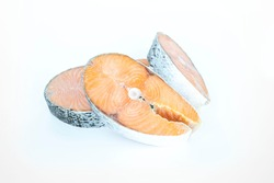 frozen raw steaks of atlantic salmon isolated on white background. The concept of healthy eating. Healthy fast food