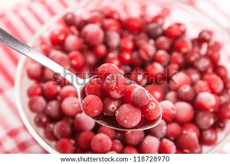 frozen red cranberry in bowl on napkin