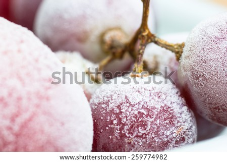 Frozen red grapes A white flake ice, #259774982