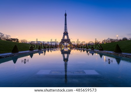 Frozen reflections in Paris, France. Eiffel Tower at sunrise from Trocadero Fountains