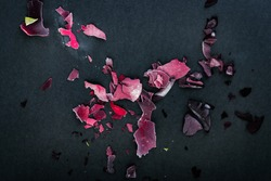 Frozen rose petals on black background