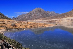 frozen sela lake at sela pass near tawang hill station in arunachal pradesh, india