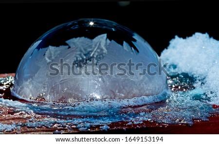 Frozen soap bubble with ornate design