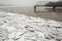 Frozen Susquehanna RIver banks in Harrisburg, PA on snowy winter day.