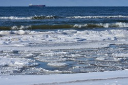 Frozen the Baltic Sea coast covered with ice floes on cold wintry day.