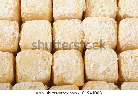 Frozen tofu on white background - stock photo