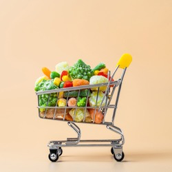 Frozen vegetables assorted in toy shopping cart on cream background. Full of assorted frozen vegetables food shop trolley at beige or yellow backdrop. Minimalistic concept.