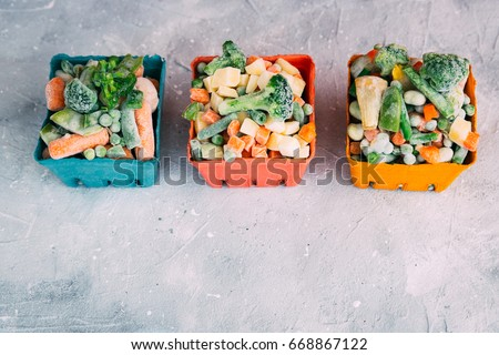 Frozen vegetables. Frozen vegetable mixture of carrots, corn and peas. #668867122