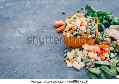 Frozen vegetables. Frozen vegetable mixture of carrots, corn and peas. #668867239